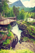 Tourist with camera on Gudbrandsjuvet waterfall, Norway - 217576525