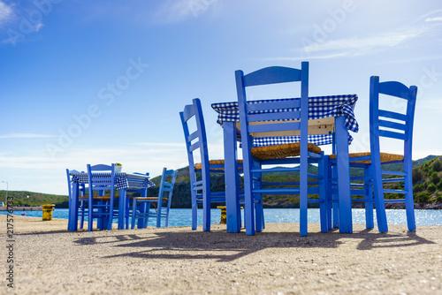Naklejka Open cafe outdoor restaurant in Greece on sea shore