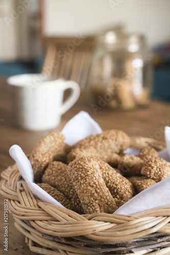 Foto Murales freshly baked homemade sesame biscuits in wicker basket