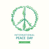 International Peace Day. Vector poster with symbol of peace consists of green olive branches. - 217584706