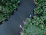 Boats at the wild river. - 217591537