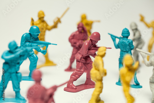 macro group of plastic toy soldiers making war