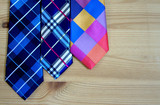 Fashion ties on the background of wooden boards. background and concept.