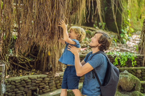 Fotobehang Bali Dad and son travelers discovering Ubud forest in Monkey forest, Bali Indonesia. Traveling with children concept