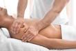 Leinwanddruck Bild - Young man receiving massage in salon, closeup