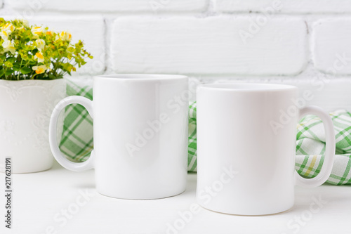 Two coffee mug mockup with yellow and green flowers