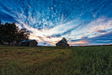 Two Old Barn Houses In The Late Summer Sunset - 217635523