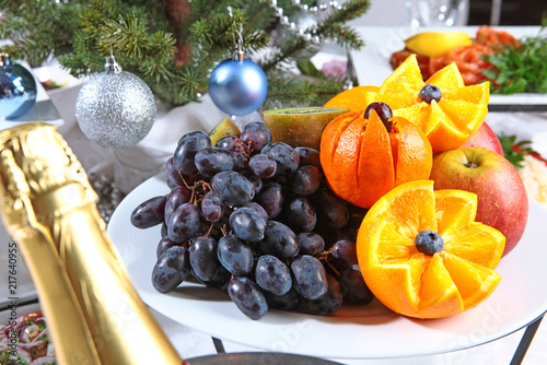 Foto Murales Fruits on a beautifully sealed table for the New Year or Christmas.