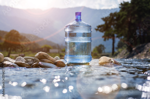 Natural mineral water in a large bottle © arttim