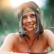 Quadro Portrait of a Woodstock Hippie style girl. With flower in the mouth