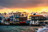 Colourful Traditional houses over the sea on a Mykonos island at sunset, greek little Venice - 217655110