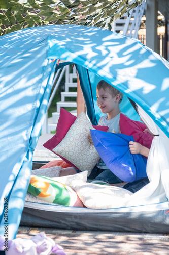 Foto Murales Portrait of cute boy inside tent at backyard