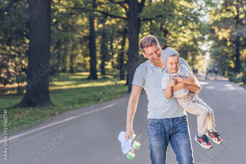 Happy family with a skateboard