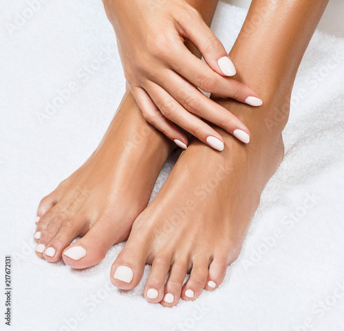 Beautiful female feet with perfect manicure.