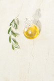 Season of olive oil. Mediterranean background with olive oil and olive branch with copy space, vertical format - 217675166