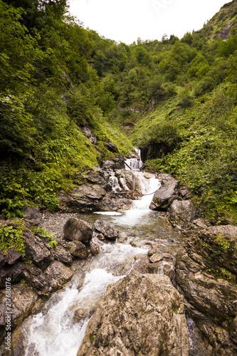 Kleiner Wasserfall im Allgäu, Bayern, Deutschland - 217680176