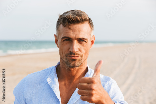 Portrait of a handsome man in shirt standing