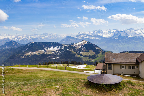 Green grass field on top of Rigi Kulm Luzern Switzerland with Alps snow mountain view a - 217694956