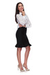 sexy businesswoman wearing high heels standing and thinking