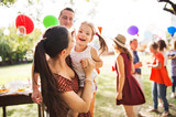 Family celebration or a garden party outside in the backyard. - 217705355