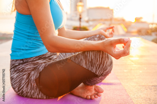 Obraz na płótnie Close up hands. Woman do yoga outdoor. Woman exercising vital and meditation for fitness lifestyle club at the nature background. Healthy and Yoga Concept