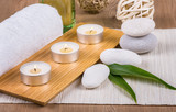 Spa concept / Spa decoration with candles, towels and stones - 217706575