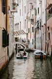 Couple sailing on Venetian canal