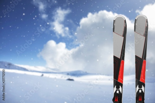 Foto Murales Pair of Black Skis on winter background