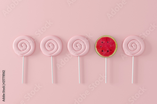 Watermelon candy on pastel pink background. different concept. minimal fruit © aanbetta