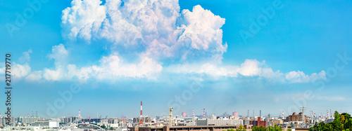 Foto Murales 青空と雲とビル群