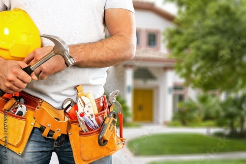 Worker with a tool belt. Isolated over