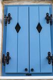 Blue wooden window in a Greece island.