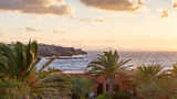 rocky sea shore of northern Crete in sunset light