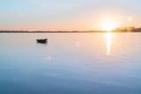 Tauranga Harbour sunrise  glow across water at dawn. - 217765142