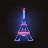 Eiffel tower in neon light on brick