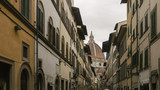 Street of Florence, Italy with the Dome of the Florence Cathedral