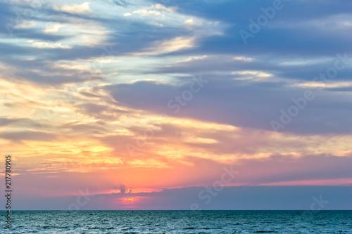 Foto Murales Scenic sunset over the blue sea