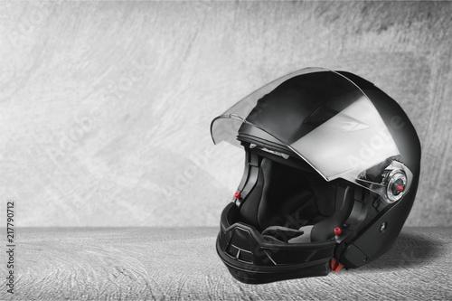 Aluminium Fiets Black biker helmet on gray background