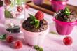 Sweet chocolate cupcake on pink background