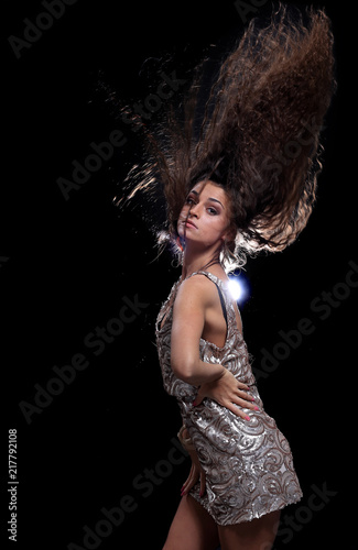 Young brunette woman dancing in a night disco club. - 217792108