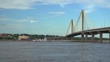 A towboat with barges is passing under the Clark bridge on the Mississippi River at Alton. - 217796710