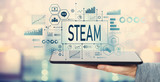 STEAM with man holding a tablet computer - 217804101