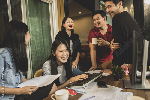 Sticker younger asian freelance laughing with happiness face in home office