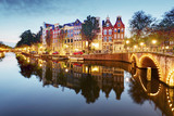 Amsterdam in Netherlands at night - 217825773