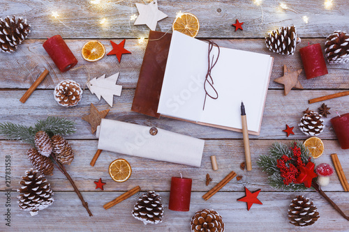 Foto Murales Above view on christmas table with note book