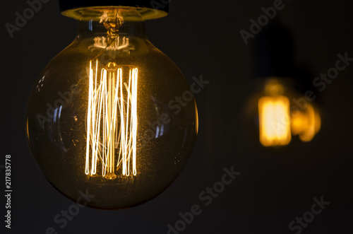 Foto Murales light bulb on a black background