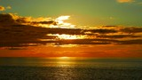 sunset on the ocean with brilliant colors - 217842362
