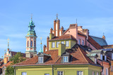 Characteristic roofs of historic tenement houses and towers of churches in Warsaw old town.