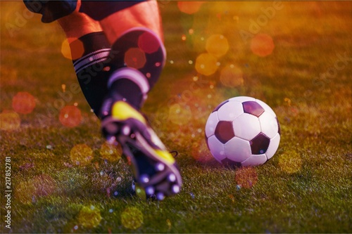 Poster Young sporty man in uniform play soccer