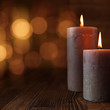Leinwanddruck Bild - Burning candles and golden lights